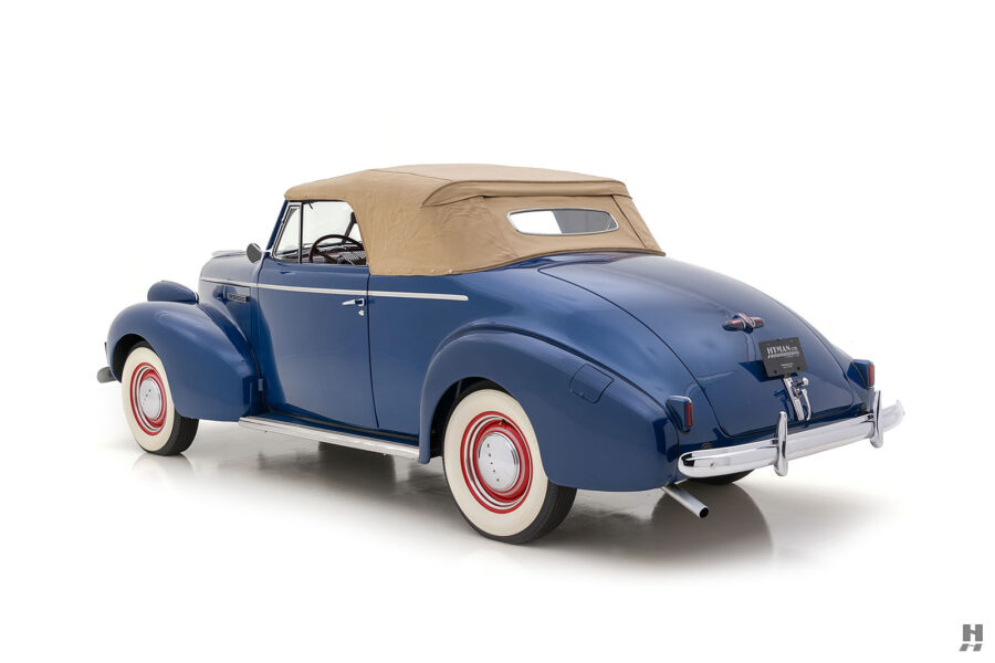 angled side view of vintage 1939 Buick Convertible car for sale at Hyman automobile dealers