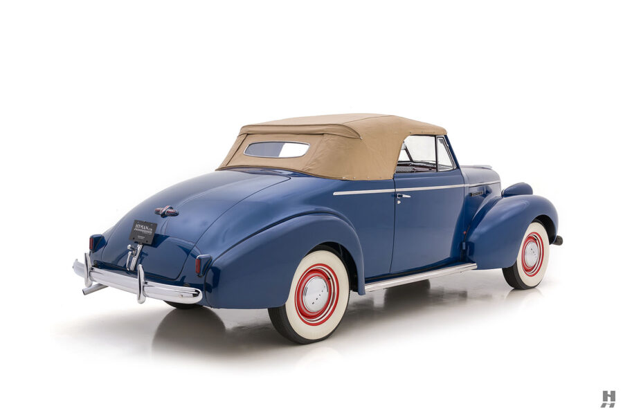 Angled backside view of classic 1939 Buick Convertible - find more cars at Hyman consignment dealership