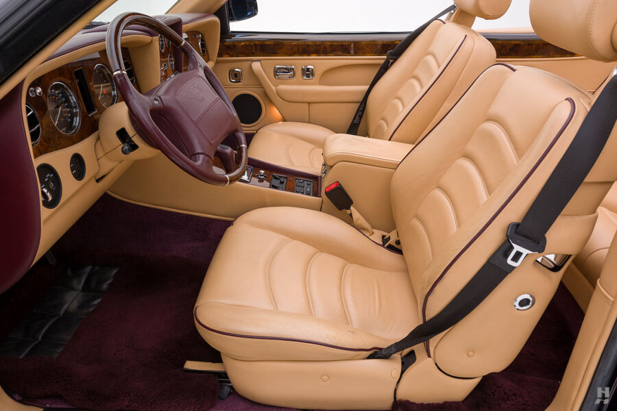 View of Driver and Passenger Seats and Steering Wheel on Old 2001 Bentley Car at Hyman Dealers