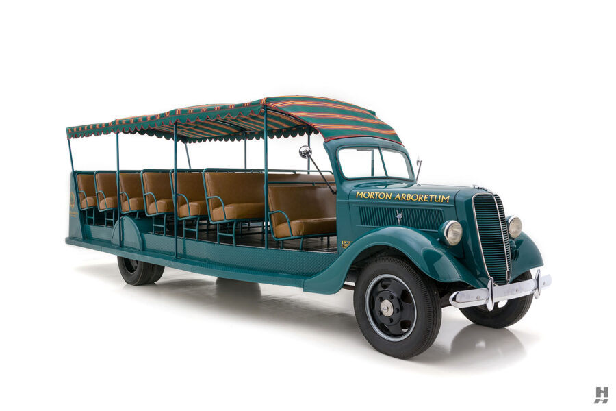 angled frontside of restored ford model bb touring bus for sale at hyman car dealers