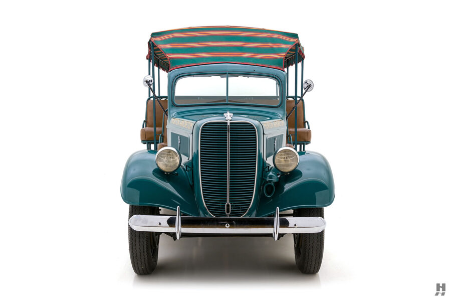 front of restored ford model bb touring bus for sale at hyman car dealers