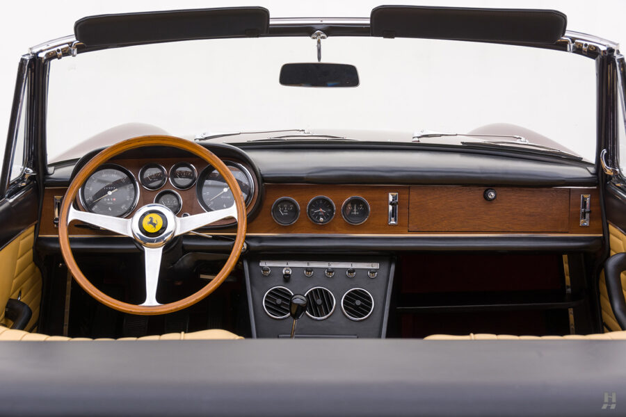 Steering wheel, dashboard, and front window of classic 1967 Ferrari Spyder Convertible for sale at Hyman consignment dealers in St. Louis, Missouri