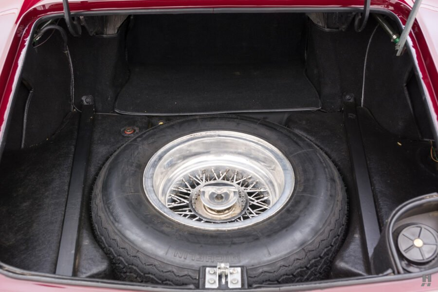 Spare tire in trunk of classic 1967 Ferrari Convertible for sale - find more antique cars at Hyman consignment dealers in St. Louis, Missouri