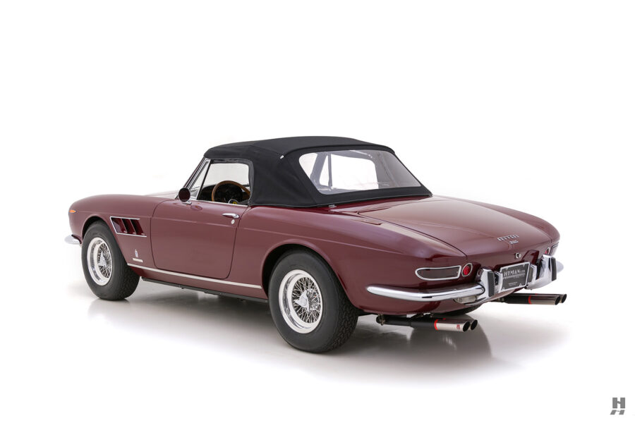 Angled backside view of classic 1967 Ferrari Spyder Convertible car for sale at Hyman consignment dealers near you