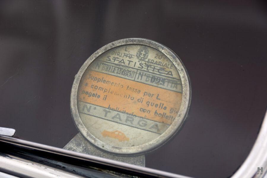 logo on vintage 1938 lancia cabriolet for sale at Hyman