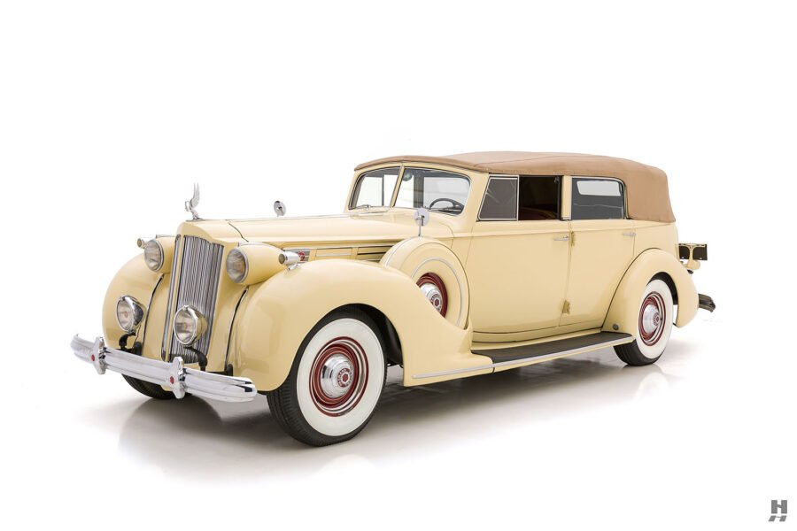 Angled front side view of classic 1938 Packard Convertible car at Hyman