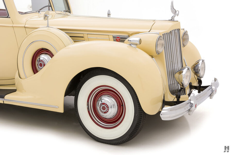Angled side front view of classic 1938 Packard car for sale at Hyman dealers