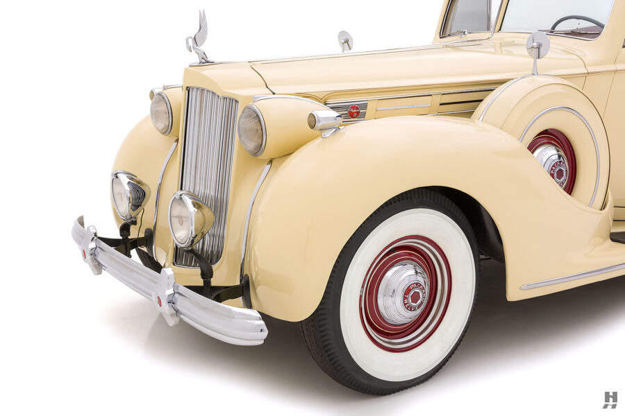 angled front view of classic 1938 Packard car for sale at Hyman dealers
