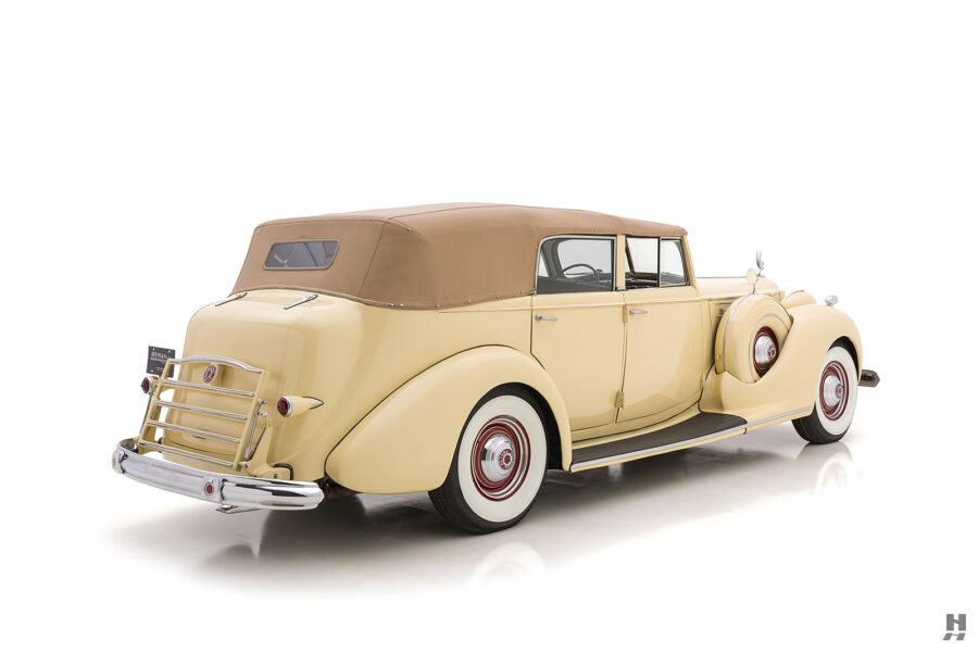 Angled back right side view of classic 1938 Packard Convertible for sale at Hyman