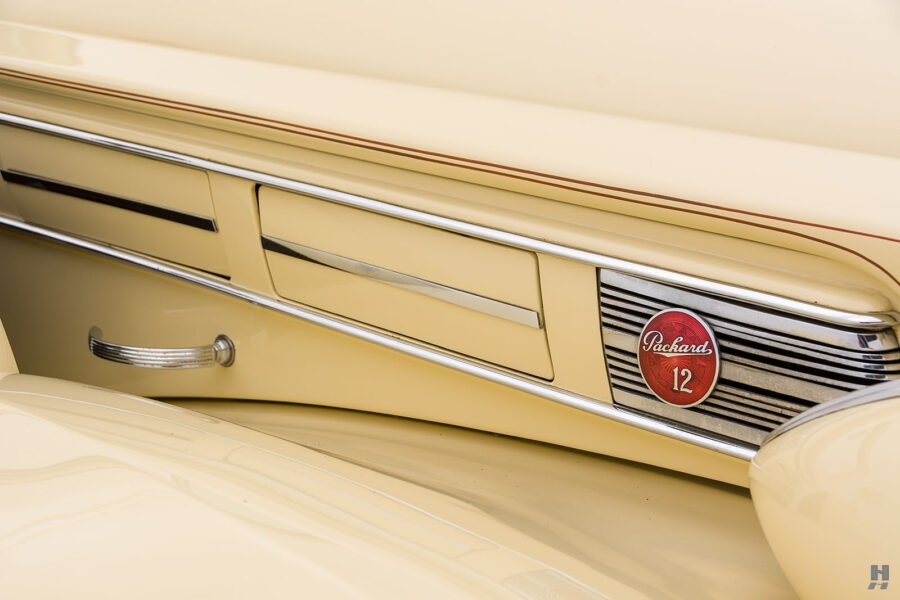 Close up of classic 1938 Packard logo on automobile for sale at Hyman vintage vehicle dealers in St. Louis
