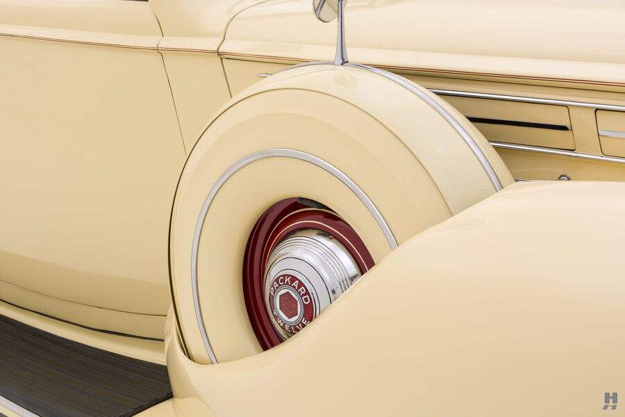 Spare tire on classic 1938 Packard Convertible Sedan car for sale at Hyman vintage consignment dealers in St. Louis