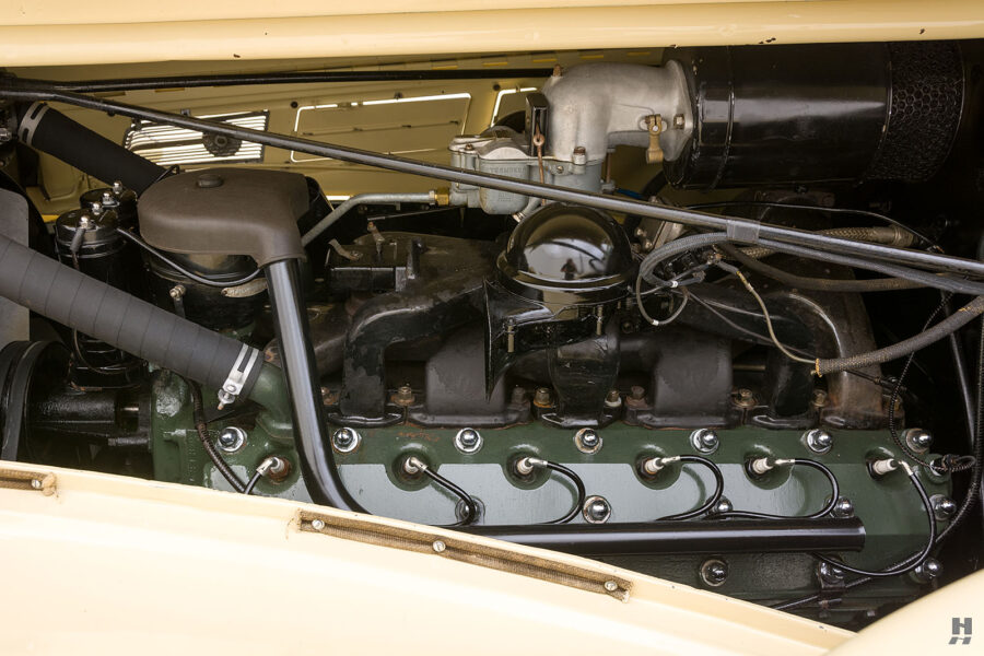 Close up of engine of classic 1938 Packard Convertible Sedan for sale at Hyman car dealership in St. Louis, Missouri