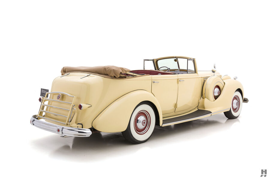 Angled back view of classic 1938 Packard Convertible Sedan for sale at Hyman car dealership in St. Louis, Missouri