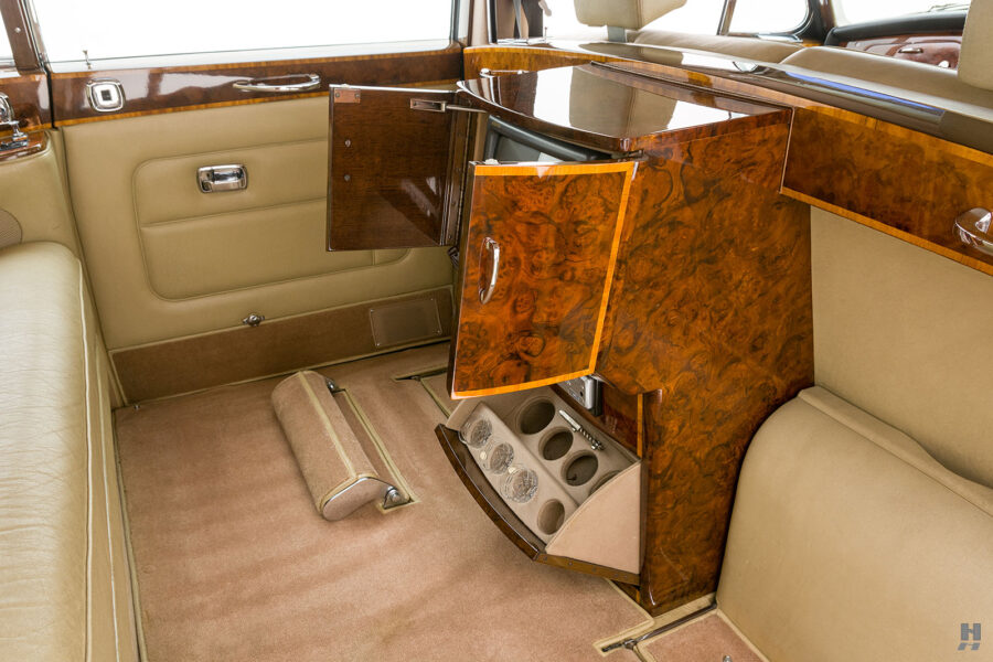 Interior view of backseat and TV in vintage 1975 Rolls-Royce Phantom - find more cars for sale at Hyman in St. Louis, Missouri