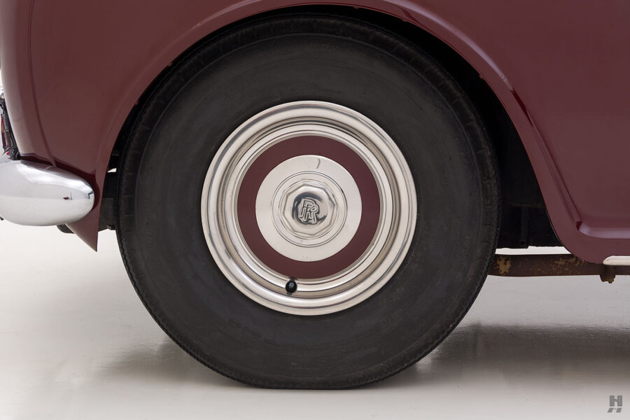 Back tire of old 1975 Rolls-Royce Phantom model for sale at Hyman consignment dealers near you