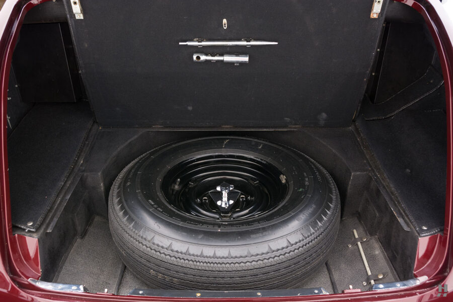 Spare tire in trunk of old Rolls-Royce Phantom model car for sale at Hyman consignment dealers in St. Louis