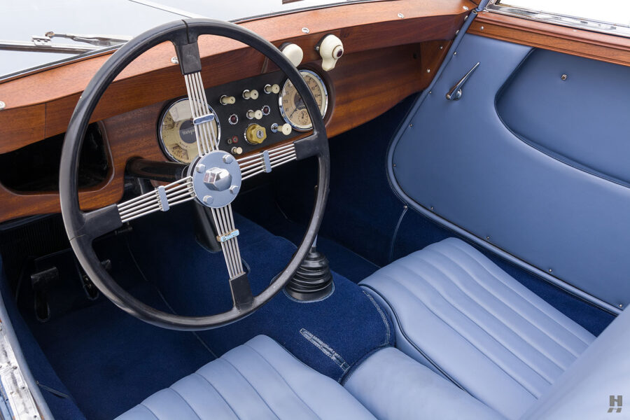Angled view of steering wheel and dashboard in used 1953 Morgan Coupe - find more exotic cars for sale at Hyman in St. Louis, Missouri