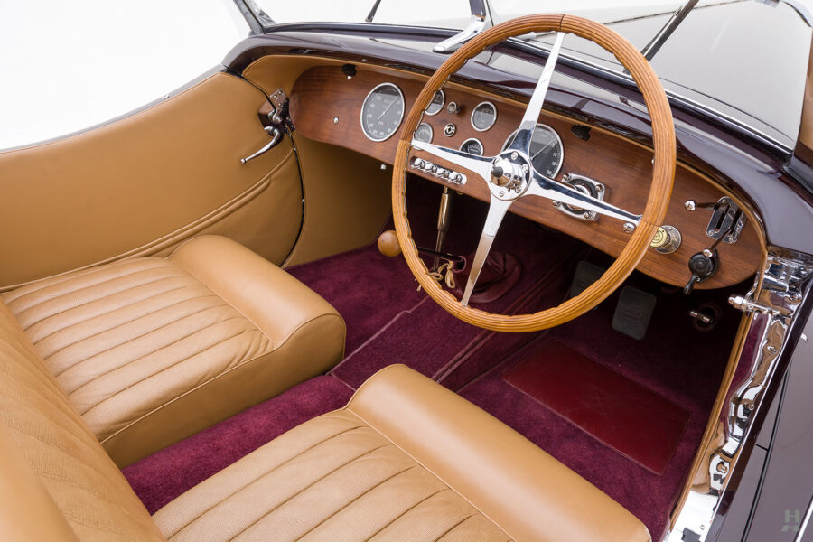 steering wheel, dashboard, and passenger's seat on vintage bugatti convertible for sale at hyman