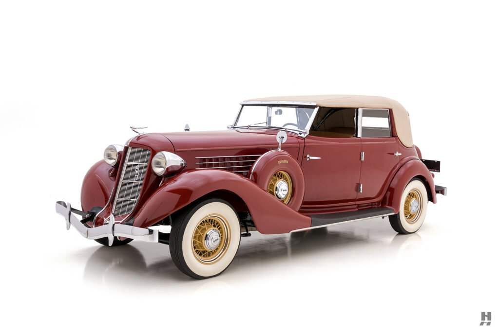 angled frontside of old 1935 auburn convertible sedan for sale at hyman automobile dealers