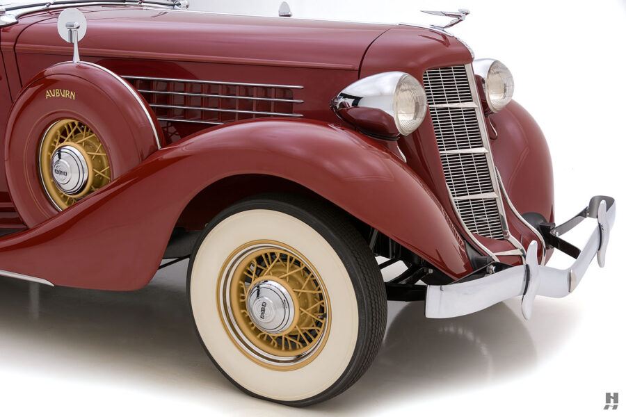 angled frontside of old 1935 auburn convertible sedan for sale at hyman classic cars