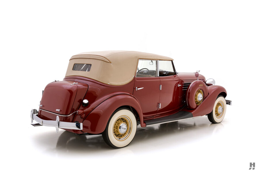 angled backside of old 1935 auburn convertible sedan for sale at hyman automobile dealers
