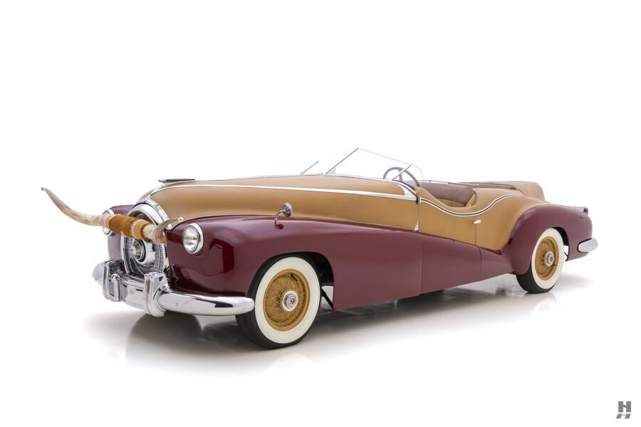 angled frontside view of antique 1932 duesenberg speedster for sale at hyman classic car dealers