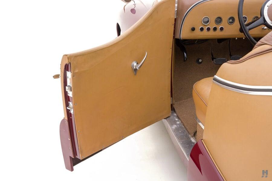 driver's side door of antique 1932 duesenberg speedster for sale at hyman classic car dealers