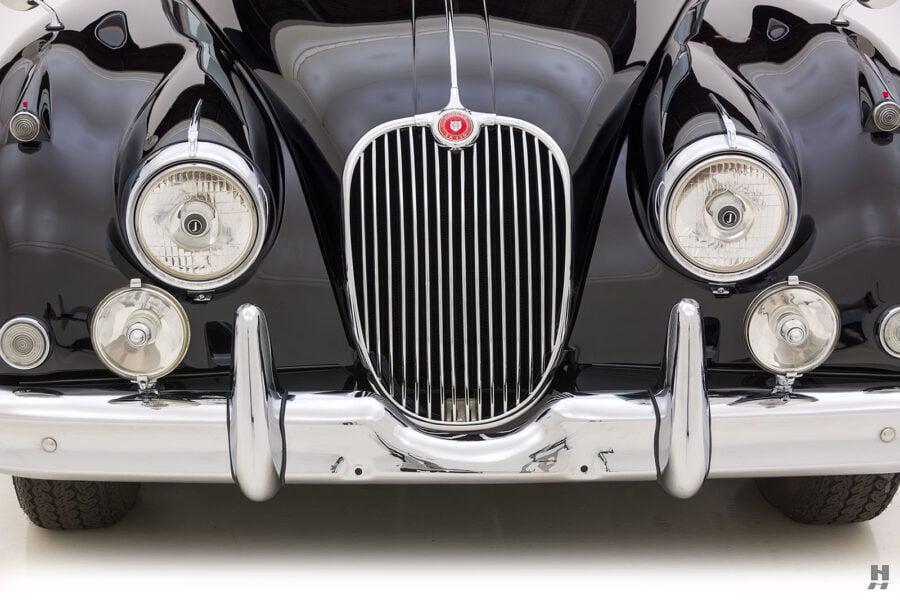 front of classic 1959 jaguar for sale at hyman car dealers