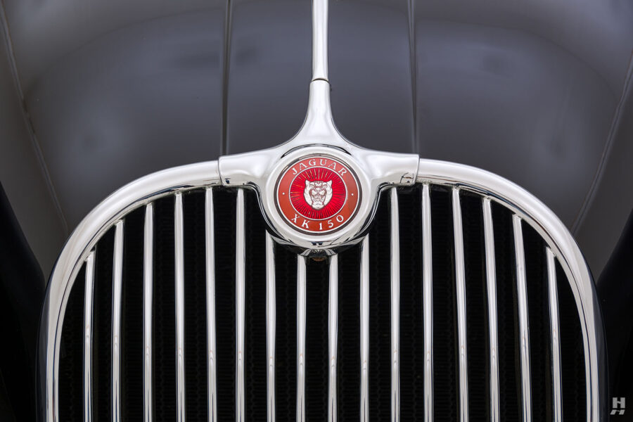 logo on the front grill of classic 1959 jaguar roadster for sale at hyman dealers