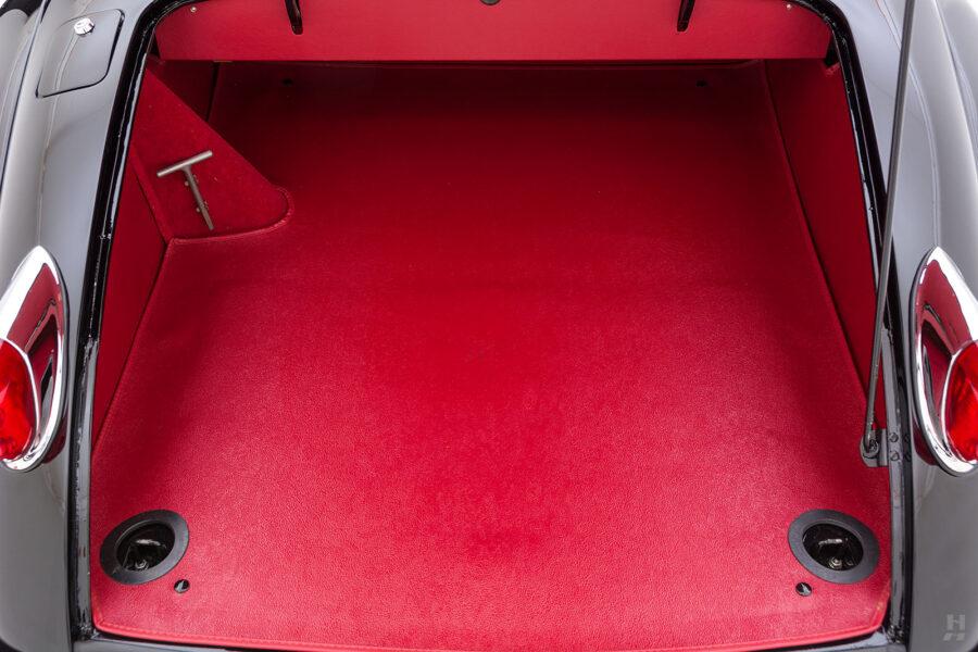 trunk of classic 1959 jaguar for sale at hyman automobile dealers