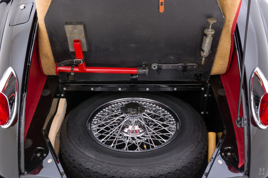 spare tire and trunk of classic 1959 jaguar for sale at hyman automobile dealers