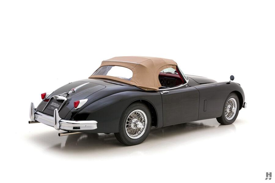 angled backside of classic 1959 jaguar for sale at hyman car dealers