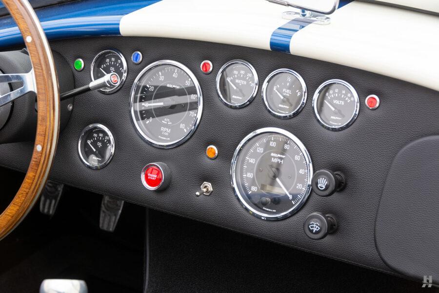 dashboard on vintage 1965 backdraft cobra at hyman classic car dealership