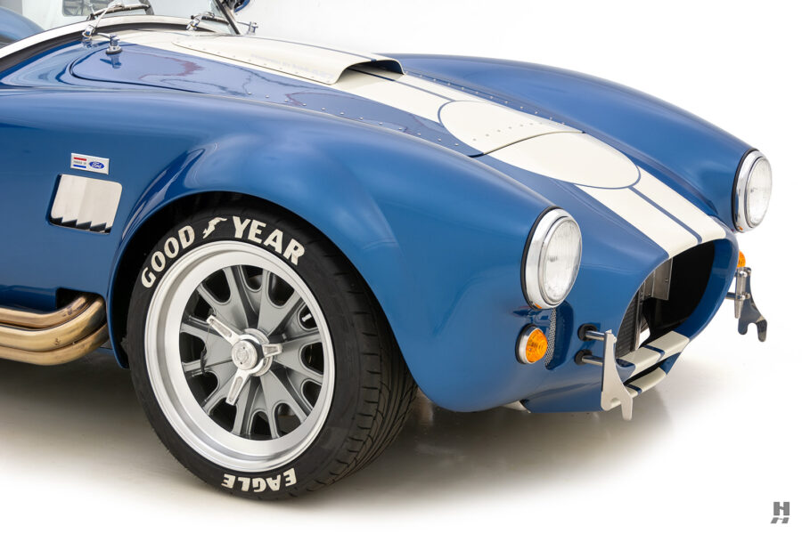 angled front view of vintage 1965 backdraft cobra from hyman classic car dealership
