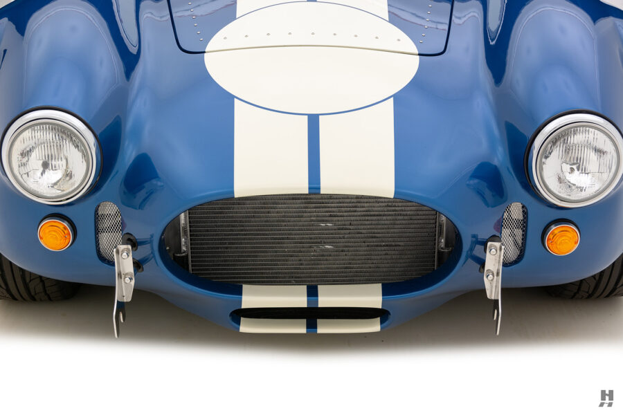 front of vintage 1965 backdraft cobra from hyman classic car dealership