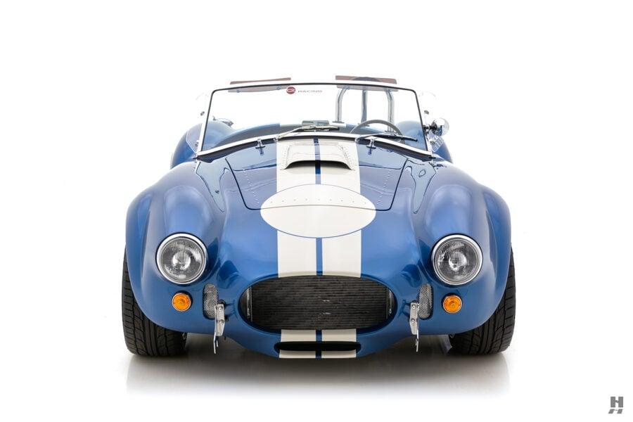 front of vintage 1965 backdraft cobra roadster for sale at hyman automobile dealers