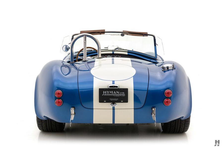 back of vintage 1965 backdraft cobra roadster for sale at hyman automobile dealers