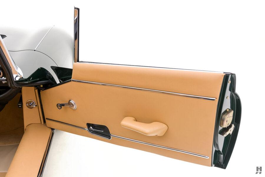passenger's side door of vintage jaguar roadster for sale at hyman classic cars
