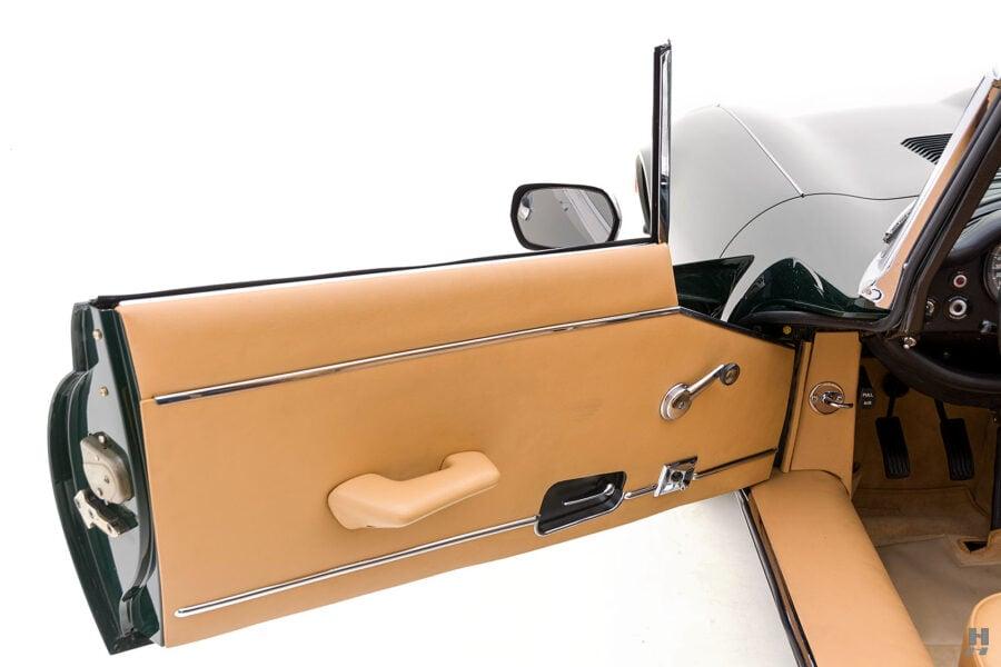 driver's side door of vintage jaguar roadster for sale at hyman classic cars