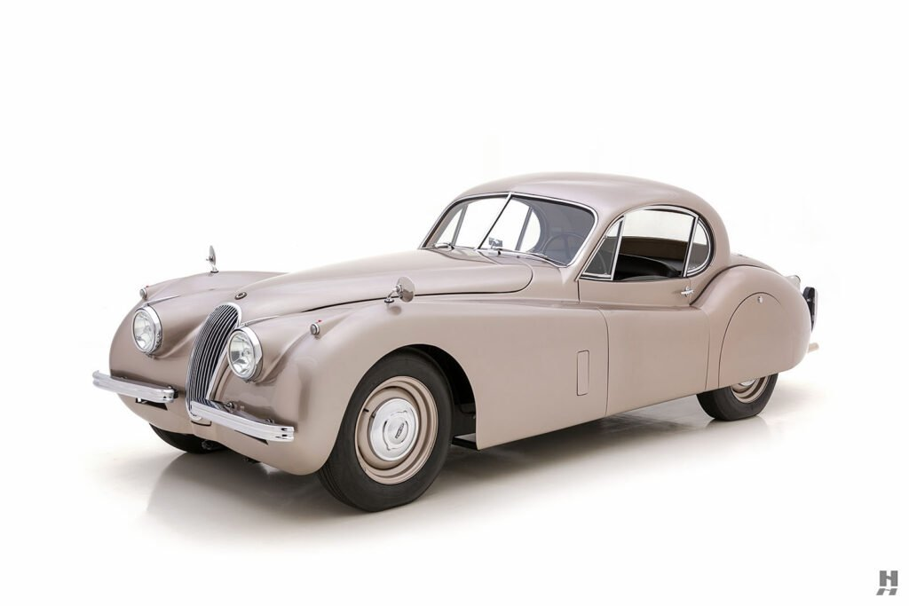 angled side view of antique jaguar coupe for sale at hyman classic dealers