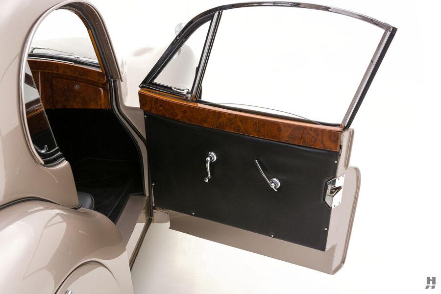 passenger's side door of antique jaguar coupe for sale at hyman classic dealers