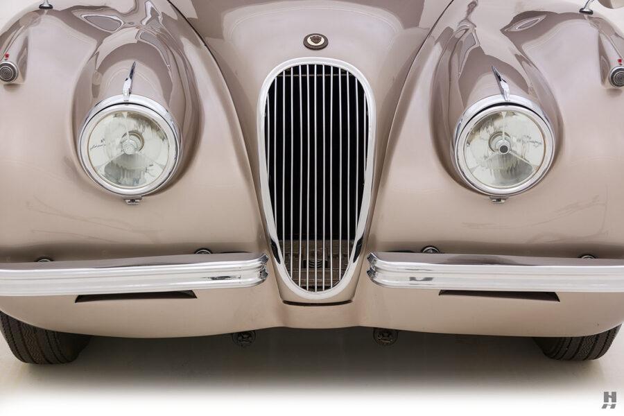 front of antique jaguar coupe for sale at hyman classic dealers