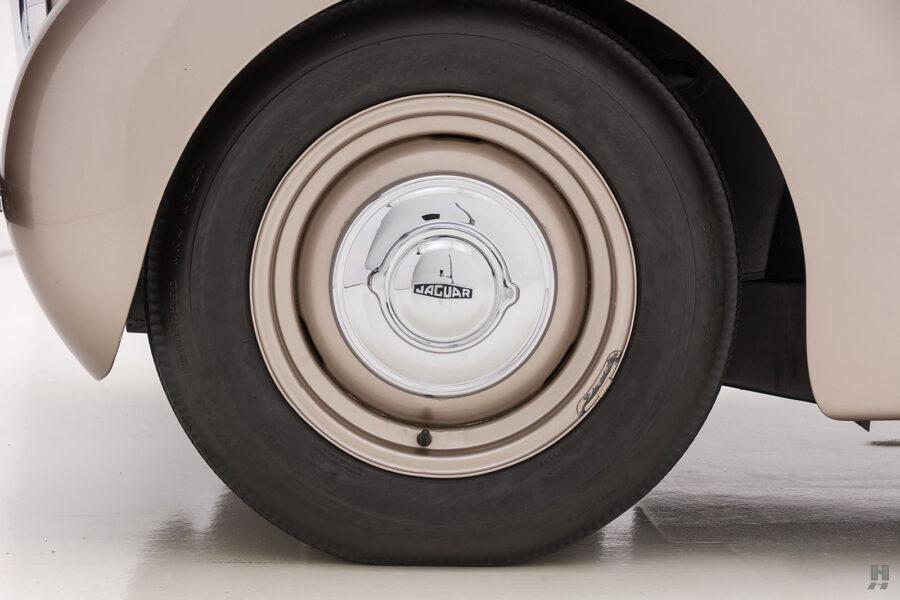 back tire of antique jaguar coupe for sale at hyman classic dealers