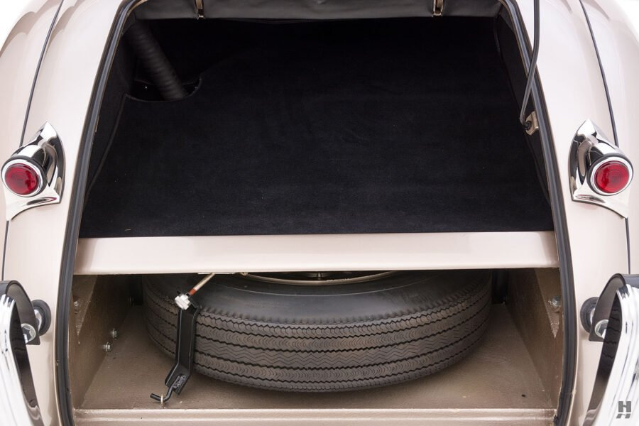 trunk and spare tire of antique jaguar coupe for sale at hyman classic dealers