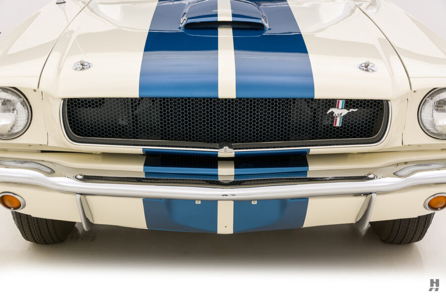 front of the vintage 1965 shelby gt350 for sale at hyman car dealers