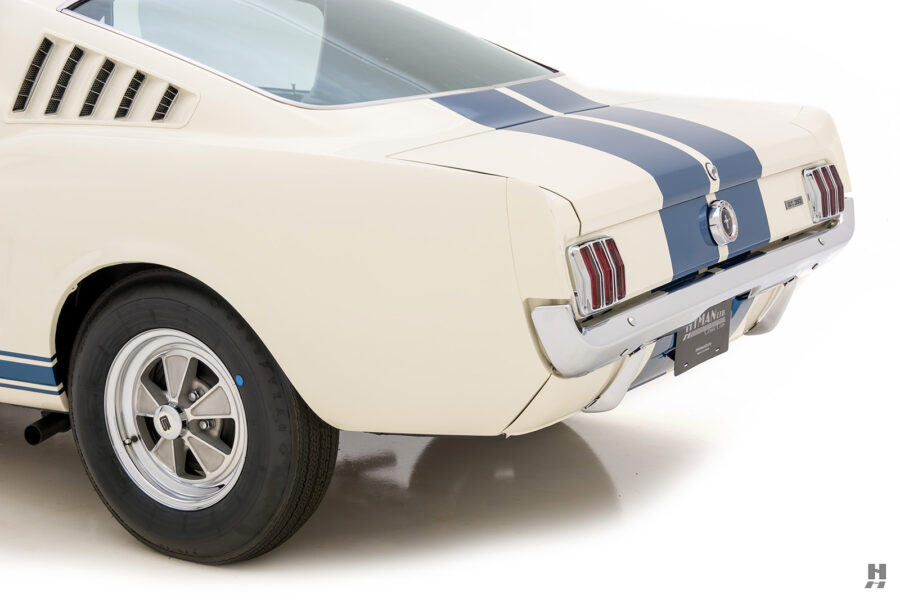 angled back view of vintage 1965 gt350 car for sale at hyman automobile dealers