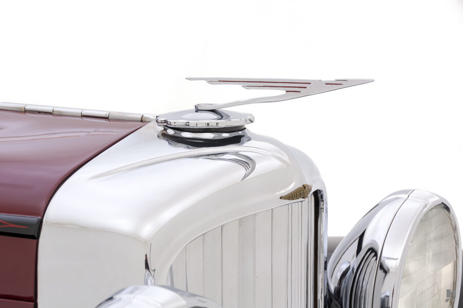 metal piece on antique 1930 duesenberg for sale at hyman classic cars