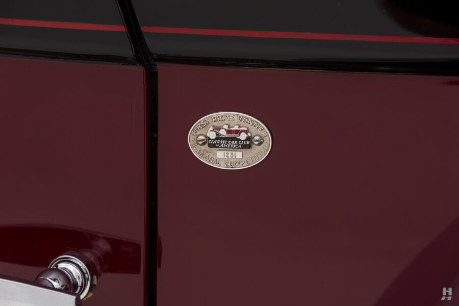 logo on antique 1930 duesenberg for sale at hyman classic cars